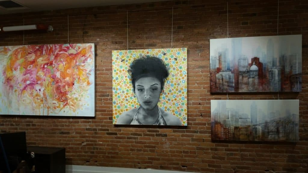 North Vancouver artist Sandrine Pelissier painting in gallery Bloom in Montreal Canada